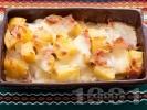 Рецепта Запечени картофи с шунка, кашкавал и кисели краставички